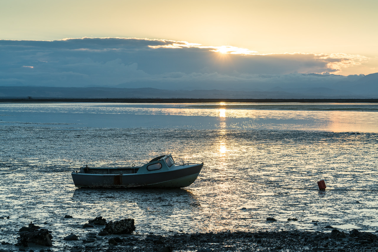 Sunset with low tide and a boat at Marybank.