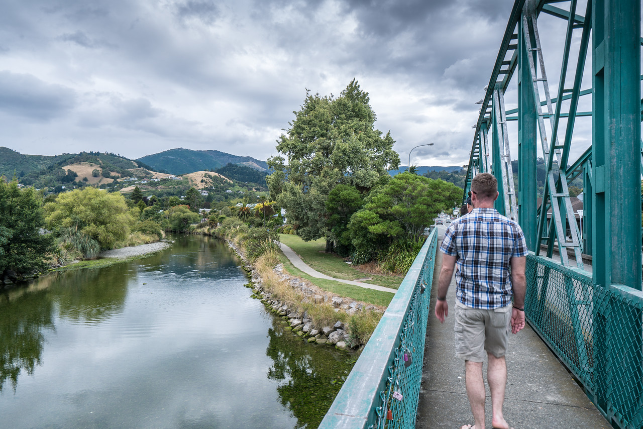 Shawn walking across the Trafalgar Street Bridge in Nelson.