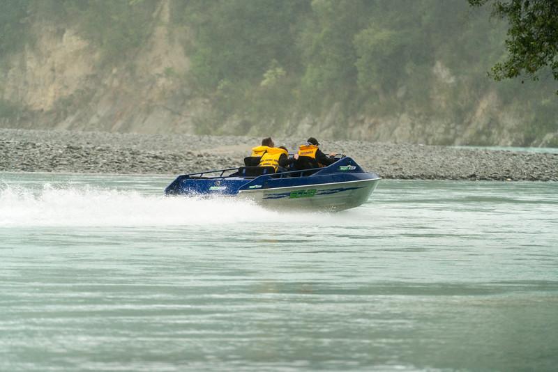 Richard, Matthew and Tim heading up the Rakaia River. Yep, it's raining!