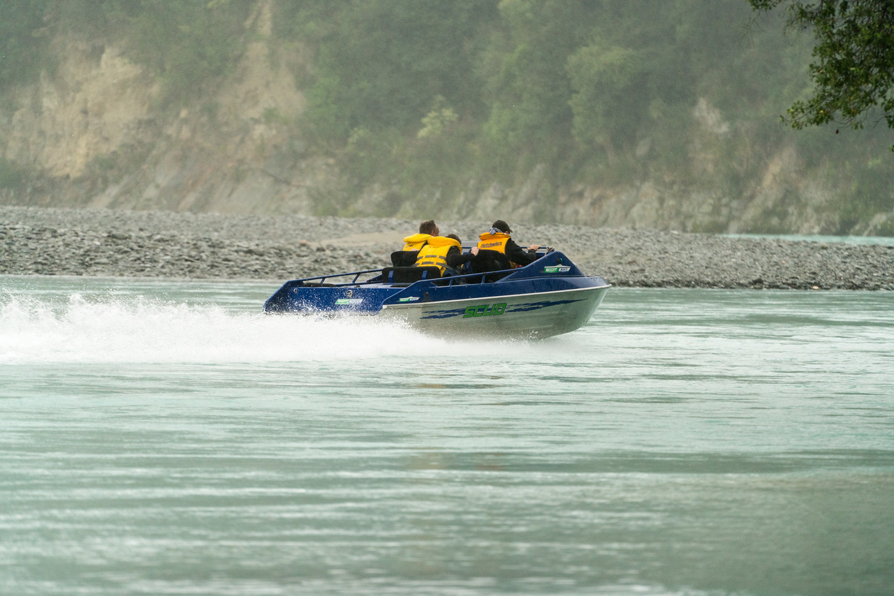 Richard, Matthew and Tim heading up the Rakaia River. Yep, it's raining!