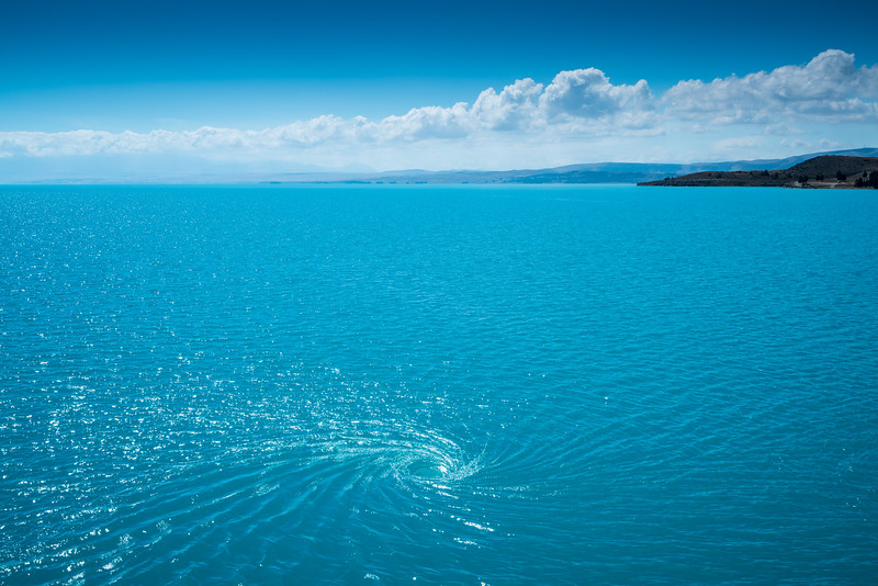 A giant whirlpool forms as the water leaves Lake Pukaki to head to the power station. You might not want to kayak too close to that!