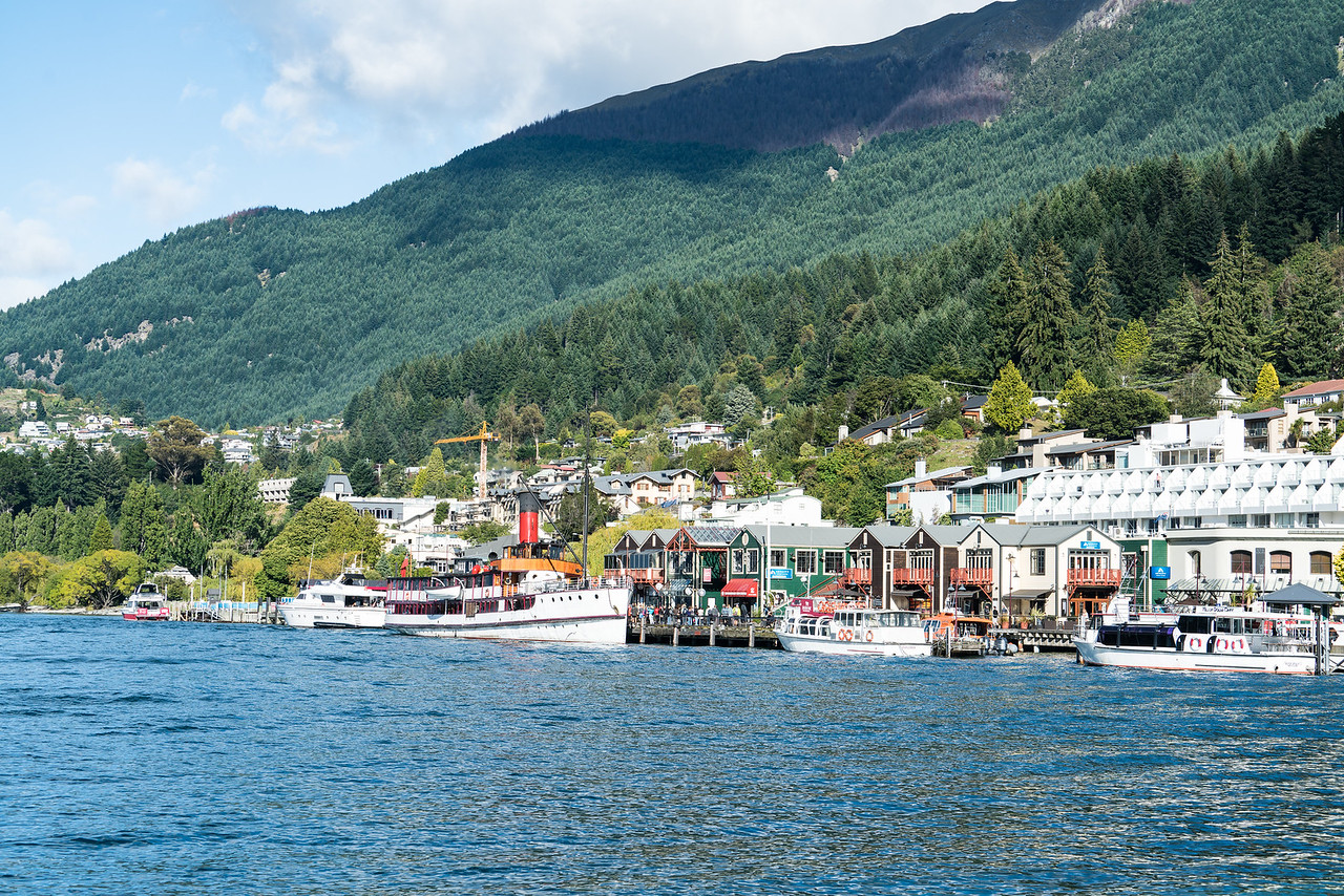 The Queenstown Waterfront with the coal fired steamship Earnslaw at the dock.