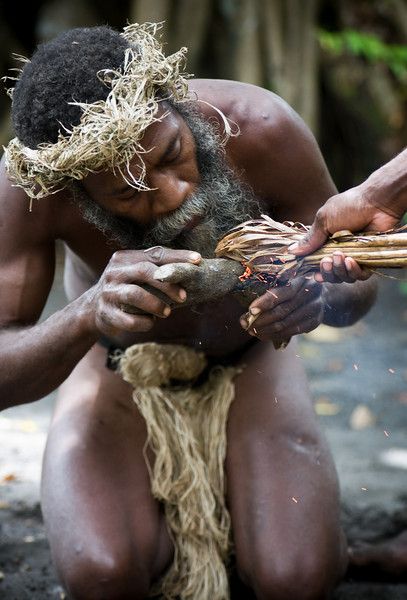 A kastom (i.e. traditional) man demonstrating the traditional way to make fire.  (Yes, it was by rubbing two sticks together.)<br /> <br /> Location: Tanna island, Vanuatu<br /> <br /> Lens used: 70-200mm f2.8 IS