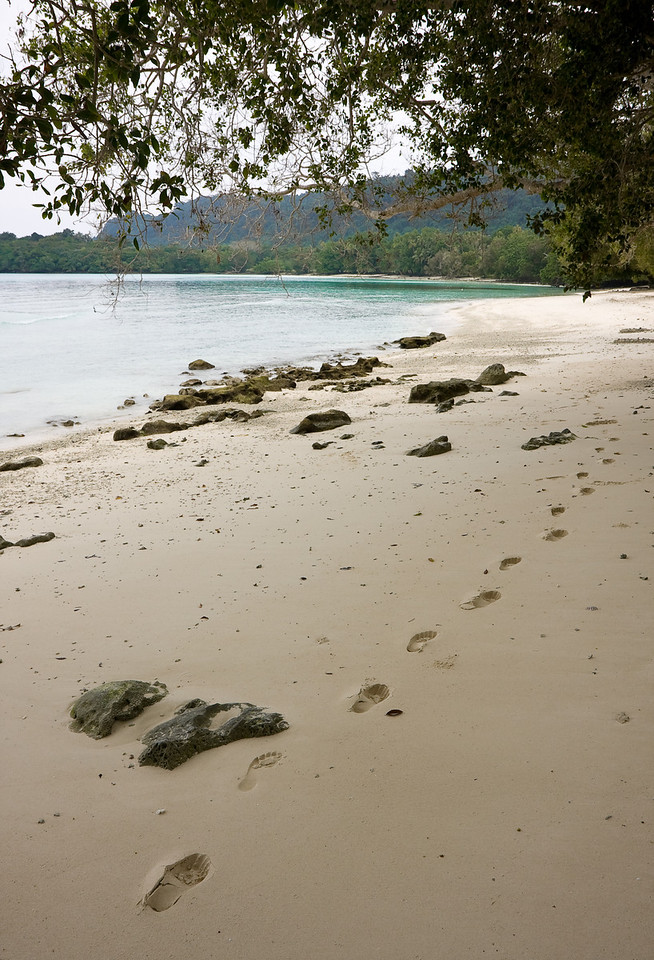 Lone footprints on Lonnoc beach.<br /> <br /> Location: Santo island, Vanuatu<br /> <br /> Lens used: 17-55mm f2.8 IS