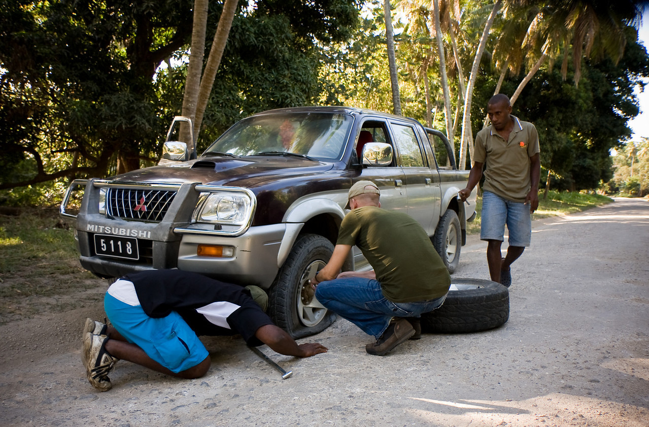 Peter, from Germany helped out the two drivers when our tire went flat.<br /> <br /> Location: Tanna island, Vanuatu<br /> <br /> Lens used: 17-55mm f2.8 IS