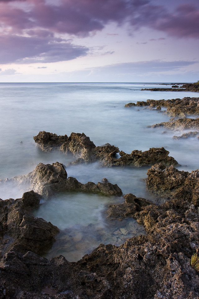 A long exposure smoothed out the gentle waves brushing up against the sharp volcanic shoreline.<br /> <br /> Location: Tanna island, Vanuatu<br /> <br /> Lens used: 17-55mm f2.8 IS with a 2-stop, soft step Grad ND filter