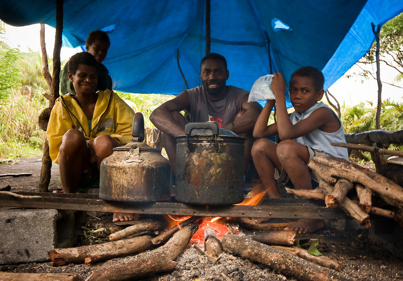 Joses and his family at the permanent camp up on the ash plain in the middle of the island.<br /> <br /> Location: Ambrym island, Vanuatu<br /> <br /> Lens used: 17-55mm f2.8 IS
