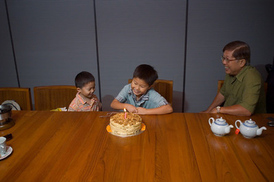 Edgar and Sean lurking suspiciously around Grandma's cake