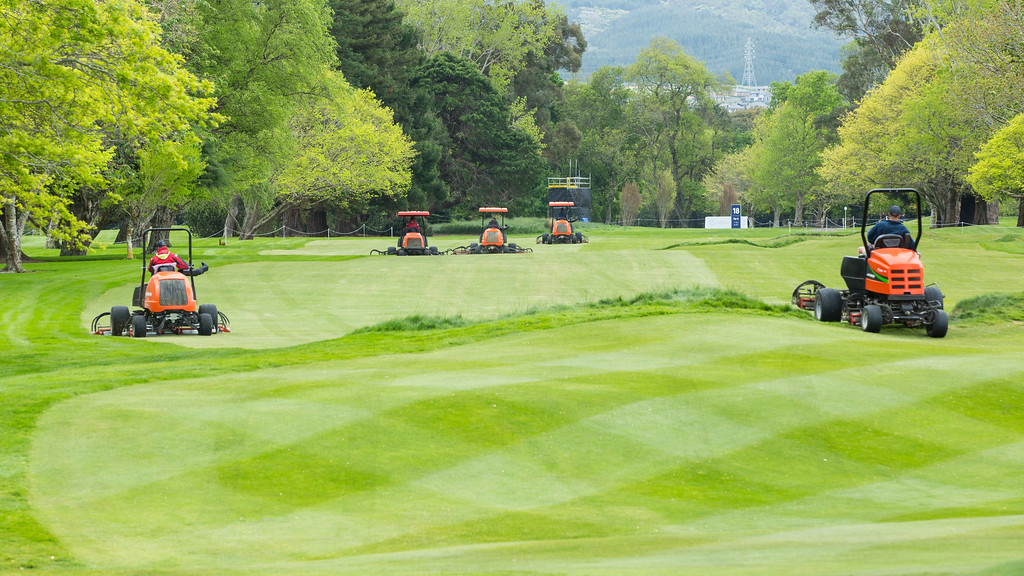 mowers at work on the  18th fairway preparing the Royal Wellington Golf Club  to host the Asia-Pacific Amateur Championship tournament 2017 held in Heretaunga, Upper Hutt, New Zealand from 26 - 29 October 2017. Copyright John Mathews 2017.   www.megasportmedia.co.nz