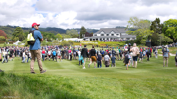 View of the clubhouse and crowds as seen by fans on the 18th geen with the final group of players on the last day of the Asia-Pacific Amateur Championship tournament 2017 held at Royal Wellington Golf Club, in Heretaunga, Upper Hutt, New Zealand from 26 - 29 October 2017. Copyright John Mathews 2017.   www.megasportmedia.co.nz