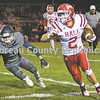 Hall running back Anthony Buchanan outruns Monmouth-Roseville's Christian Solrzan around the end for a long gain duirng Friday night's game in Monmouth. [BILL NICE/GateHouse Media]