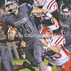 Monmouth-Roseville's CJ Daniel breaks through the line during Friday night's game against Hall. [BILL NICE/Review Atlas]