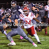 Monmouth-Roseville's CJ Daniel breaks through the line against Hall during Friday night's game in Monmouth. The Tians defeated the Red Devils 24-20. [BILL NICE/The Register-Mail]
