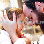 30-9-14. Rabbi Menachem Wolf from Spiritshul giving his son Noach a traditional blessing leading up to Kol Nidrei.  Photo: Peter Haskin