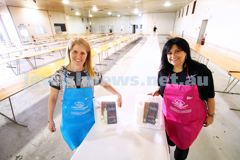 21-10-14. Getting ready for the big challah bake. As part of the Shabbat Project, Rochelle Mendel (left) and Michal Saben are setting up for the Glick's Great Challah Bake. More than 2000 people will decend on the Glick's warehouse in Clayton to taker part in Melbourne's biggest ever challah baking event.
