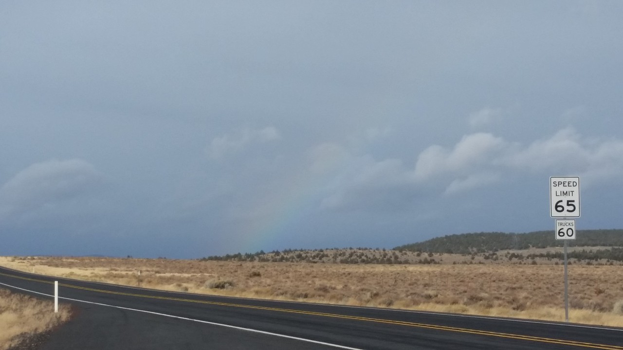 I flirted with rain and snow in the early stages of the trip before the sun came out.  You can just barely see a rainbow dead center.