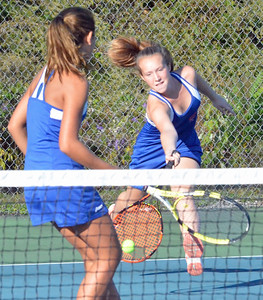KYLE MENNIG - ONEIDA DAILY DISPATCH Oneida's Catherine Brown reaches for the ball as teammate Emily Marshall looks on during their second doubles match against Whitesboro on Wednesday, Oct. 5, 2016.