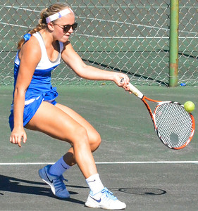 KYLE MENNIG - ONEIDA DAILY DISPATCH Cazenovia's Julia Barrett plays the ball during a third singles match against Oneida in the Section III Class B final in Utica on Friday, Oct. 7, 2016.