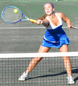 KYLE MENNIG - ONEIDA DAILY DISPATCH Cazenovia's Summer Steinhorst hits the ball at the net during a second doubles match against Oneida in the Section III Class B final in Utica on Friday, Oct. 7, 2016.