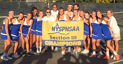 KYLE MENNIG - ONEIDA DAILY DISPATCH The Cazenovia girls tennis team poses with the championship banner after defeating Oneida 4-3 in the Section III Class B final in Utica on Friday, Oct. 7, 2016.