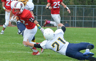 KYLE MENNIG - ONEIDA DAILY DISPATCH Vernon-Verona-Sherrill's Nate Palmer (22) avoids an attempted tackle by Central Valley Academy's Ben Stone (21) on his way to a 47-yard touchdown catch during their game in Verona on Saturday, Oct. 1, 2016.
