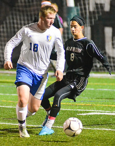 KYLE MENNIG - ONEIDA DAILY DISPATCH Madison's Ethan Snyder (18) and Stockbridge Valley's Andrew Renner (8) battle for control of the ball during their match at Morrisville State College on Saturday, Oct. 8, 2016.