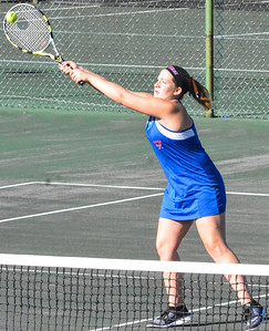 KYLE MENNIG - ONEIDA DAILY DISPATCH Oneida's Kylie Chesebro hits a shot at the net during a first doubles match in the Section III Class B final against Cazenoiva in Utica on Friday, Oct. 7, 2016.