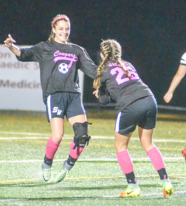 KYLE MENNIG - ONEIDA DAILY DISPATCH Stockbridge Valley's Haley Harrington, left, and Jill Jacobs celebrate after Harrington's goal against Madison during a match at Morrisville State College in Morrisville on Saturday, Oct. 8, 2016.