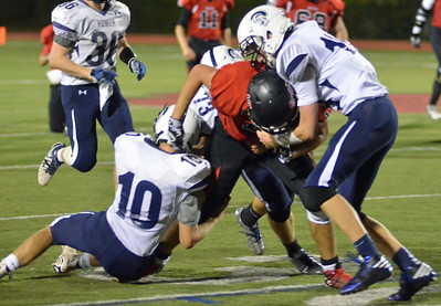 KYLE MENNIG - ONEIDA DAILY DISPATCH Chittenango's Hunter Hendrix (13) is tackled by several Homer defenders during their game in Chittenango on Friday, Oct. 7, 2016.