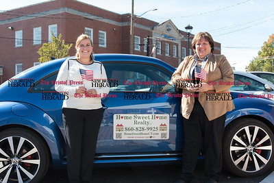 092616  Wesley Bunnell   Staff  From left Mortgage Broker Catie Allen and owner of Home Sweet Home Realty Elaine Pavasaris.