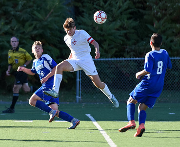 101116  Wesley Bunnell | Staff  Berlin Boys Soccer defeated Bristol Eastern 3-1 at Sage Park on Tuesday afternoon. Senior Captain Joey Leary #17 goes airborne for the header.