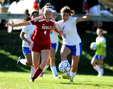 10/11/2016  Mike Orazzi | Staff Berlin's Tess Atkinson (4) and Bristol Eastern's Macy Fernance (11)  during Tuesday's soccer match in Bristol.