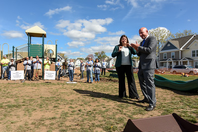 101216  Wesley Bunnell | Staff  The Simon Konover Company held a playground community building project at Industria Commons housing community on Wednesday with the help of company volunteers. Mayor Erin Stewart stands with Alderman Jim Sanders during a brief speech to the approximately 60 volunteers.