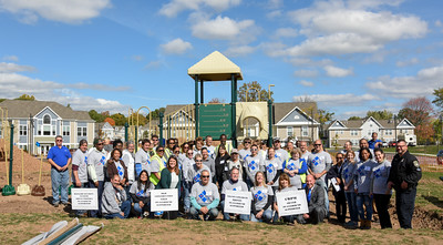 101216  Wesley Bunnell | Staff  The Simon Konover Company held a playground community building project at Industria Commons housing community on Wednesday with the help of company volunteers. Group photograph of over 60 volunteers and city officials.