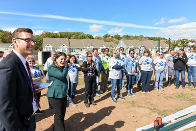 101216  Wesley Bunnell | Staff  The Simon Konover Company held a playground community building project at Industria Commons housing community on Wednesday with the help of company volunteers.  New Britain Public Affairs Specialist David Huck, left, with Mayor Erin Stewart in front of some of the approximately 60 volunteers.