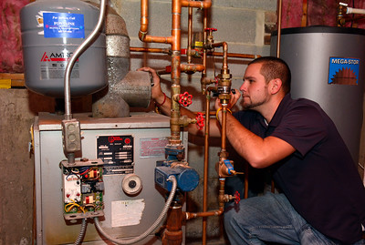 10/13/2016 Mike Orazzi | Staff Fontaine Mechanical's Sean Raymond performing a home heating inspection.