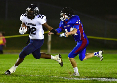 10/13/2016 Mike Orazzi   Staff St. Paul Catholic High School's Zachary Parent (44)  and Ansonia's Malcolm Martin (32) in Bristol Thursday night.