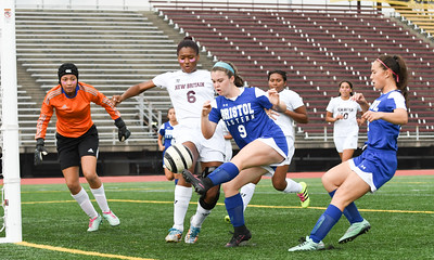 101716  Wesley Bunnell | Staff  New Britain Girls Soccer vs. Bristol Eastern at Veteran's Stadium on Monday afternoon. Bristol Eastern Sophomore Myah Croze #9 with the shot against New Britain Senior Kamaria Miller #6 and goal keeper Senior Quandeshra Minor #1.