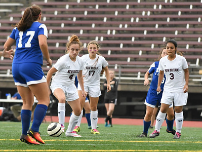 101716  Wesley Bunnell | Staff  New Britain Girls Soccer vs. Bristol Eastern at Veteran's Stadium on Monday afternoon. New Britain players Junior Eldina Begic #4, second from left & Sophomore Maya Mlynarska #17.