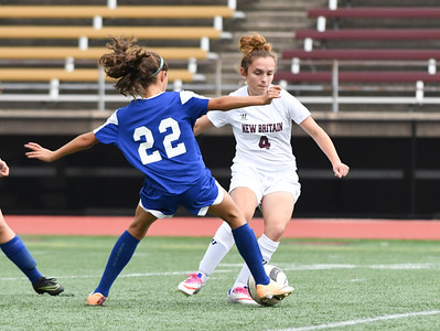101716  Wesley Bunnell | Staff  New Britain Girls Soccer vs. Bristol Eastern at Veteran's Stadium on Monday afternoon. Sophomore Kailey Laprise #22 of Bristol Eastern with Junior Eldina Begic #4.