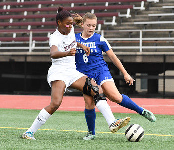101716  Wesley Bunnell | Staff  New Britain Girls Soccer vs. Bristol Eastern at Veteran's Stadium on Monday afternoon. New Britain Senior Kamaria Miller #6 and Bristol Eastern Junior Sara Tyminski #6.