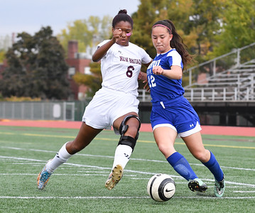 101716  Wesley Bunnell | Staff  New Britain Girls Soccer vs. Bristol Eastern at Veteran's Stadium on Monday afternoon. New Britain Senior Kamaria Miller #6 against Bristol Eastern Freshman Leah Policarpio #12.