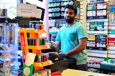 10/19/2016 Mike Orazzi | Staff Shujaat Ali while working at the UNO Convenience that was robbed Tuesday night.
