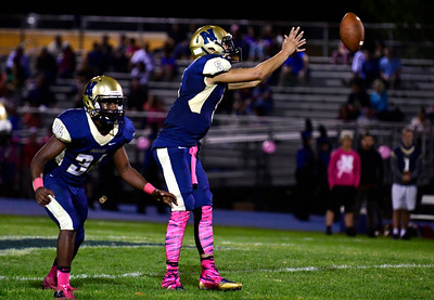 10/21/2016 Mike Orazzi | Staff  Newington's Aveontae Frazier (34) and Robert Sanchez (5) against Bristol Eastern Friday night.