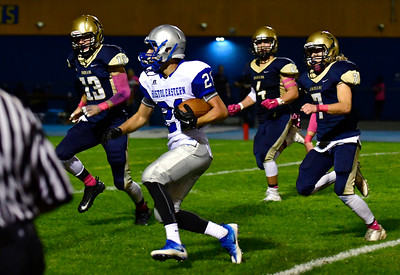 10/21/2016 Mike Orazzi | Staff  Bristol Eastern's Ariza Kolloverja (21) carries against Newington Friday night.