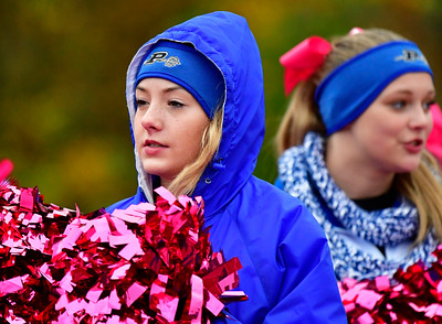 10/22/2016 Mike Orazzi | Staff A Plainville High School cheerleader during Saturday's football game RHAM in Hebron.