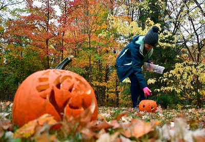 10/22/2016 Mike Orazzi | Staff Anna Meassick on the  jack-o-lantern trail during the Pumpkin Palooza at New Britain Youth Museum at Hungerford Park Saturday in Kensington.