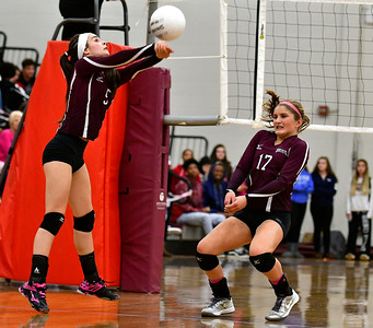 10/26/2016 Mike Orazzi | Staff Bristol Central's Brianna Saverino (5) and Peyton Greger (17) during Wednesday night's volleyball match with Bristol Eastern.
