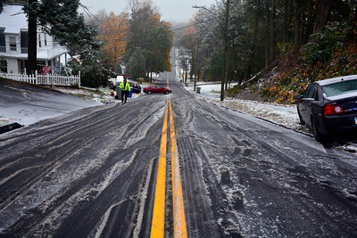 10/27/2016 Mike Orazzi | Staff A slick Woodland Street during Thursday's snowstorm.