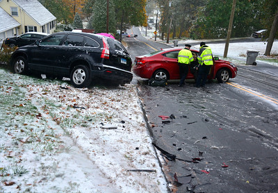 10/27/2016 Mike Orazzi | Staff The scene of a two car crash on a slick Woodland Street during Thursday's snowstorm.